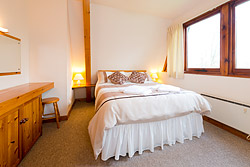 The double bedroom with wonderful views over the grounds and fishing ponds